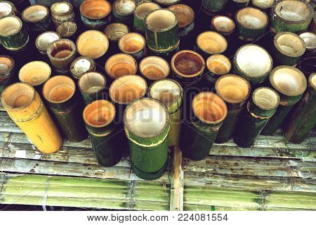 bamboo cylinder, green bamboo cup prepare use for herbal drinks in local market