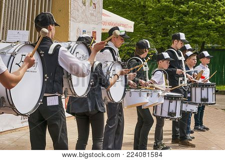 Lviv, Ukraine - May 07, 2017:Unknown drummers play during a rehearsal in the city park before the celebrations of the city's day  of Lviv., Ukraine.