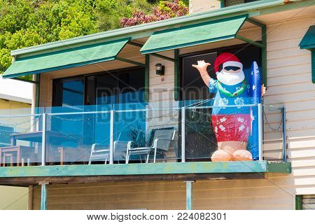Currumbin, Queensland, Australia-December 23, 2017 : Inflatable Santa Claus at house balcony. Many homeowners decorate the exterior of their houses, decorations are commonplace by early December.