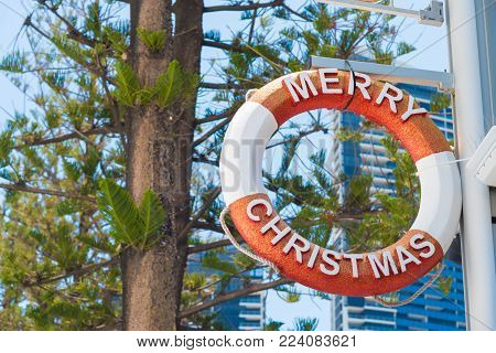 Surfers Paradise, Queensland, Australia-December 23, 2017: Merry Christmas life buoy decoration at Surfers Paradise, the Gold Coast's entertainment and tourism centre with beachside shopping and clubs