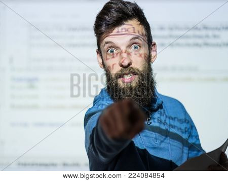 Elocution or speech craft courses. Bearded young male orator interacts with someone in the audience pointing a finger. Dialogue, discussion and rhetoric basics concept