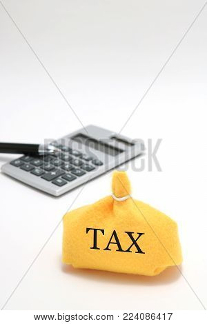 Money bag and caluculator on white background. Save money and investment concept.