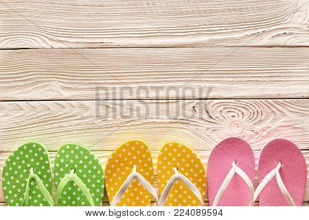 Flip flops over wooden background