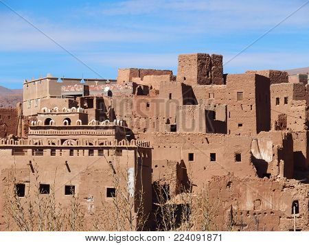 Housing estate of Tinghir old town in Atlas Mountains range landscape in southeastern Morocco with clear blue sky in 2017 warm sunny winter day, Africa on February.