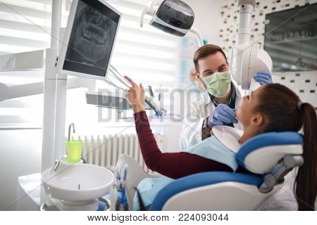 Male dentist making x-ray to patient and checkup teeth