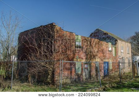Abandoned and derelict workshop and residential house waiting for demolition