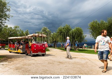 Sirmione, Italy - July 31: People Walking On Archaeological Site Of Grotte Di Catullo On The Shore O