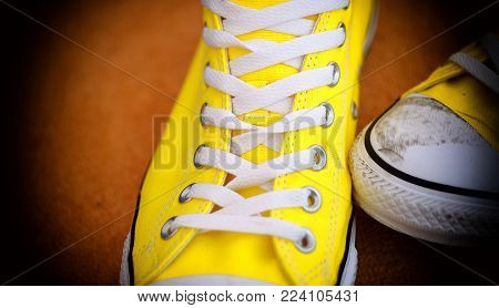 New pair of sneaker shoes with dirty toe and vignetting on the edge