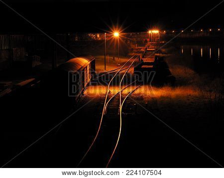 Freight station with parked wagon at night