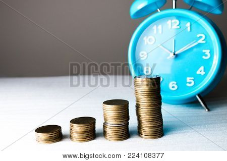 Time of saveing value money : Coin and clock, Idea of value to finance and saving money.