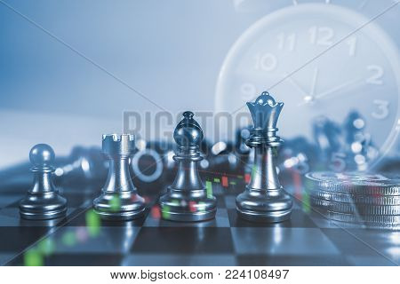 Time of saveing value money : Chess board game of business ideas and competition and strategy plan with clock background, Idea of value to finance and saving money.
