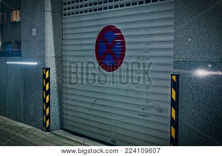 Entrance of an office building with holding sign and gate with gate