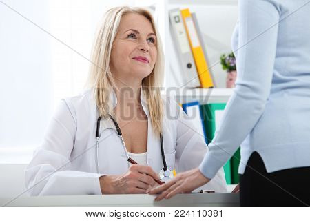 Healthcare and medical concept - doctor with patient in hospital. Doctor's consultation