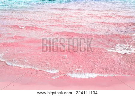 Foamy Rippled Clear Sea Wave Rolling to Pink Sand Shore Turquoise Blue Water. Beautiful Tranquil Idyllic Scenery. Tropical Beach Vacation Relaxation Paradise. Copy Space Elegant Styled Toned Image