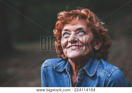 Portrait of a happy fifty year old woman, outdoors