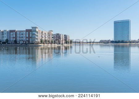 Riverside Apartment Building Complex Reflection Blue Sky