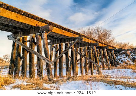 abandoned railroad timber trestle - St Vrain Creek near Platteville, Colorado