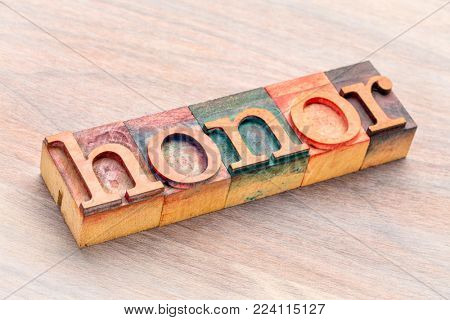 honor word abstract in  letterpress wood type printing blocks stained by color inks