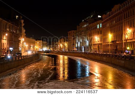 Embankment of River Moyka at night. Moyka - flow of the Neva delta in St. Petersburg at sunny spring day, Russia.