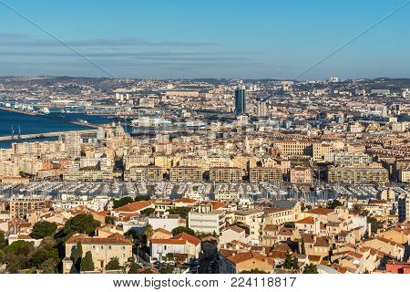 Marseille, France - December 4, 2016: Aerial panoramic view from basilica of Notre Dame de la Garde for Cathedral de la Major and the old Vieux port in Marseille, Provence, France.