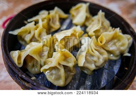 Shumai or Shaomai a Dim Sum Chinese traditional steamed dumplings food.