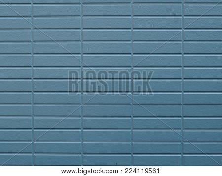 Aqua blue painted brick wall background photograph. Painted brick pattern, authentic photograph shot outdoors with natural light.