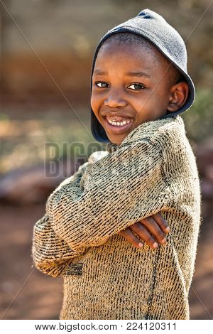 African child in the yard of a village, Botswana