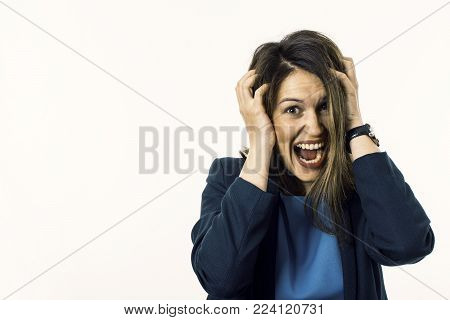 Screaming Woman Is Going Crazy Pulling Her Hair. Stress Concept.