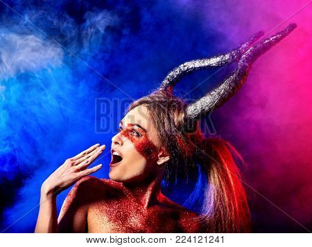 Mad satan woman on black magic ritual of in hell. Witch reincarnation mythical creature on Sabbath. Devil on Halloween. Zodiac astrology. Make-up for night club. Visions of drug addict. Astral travel.