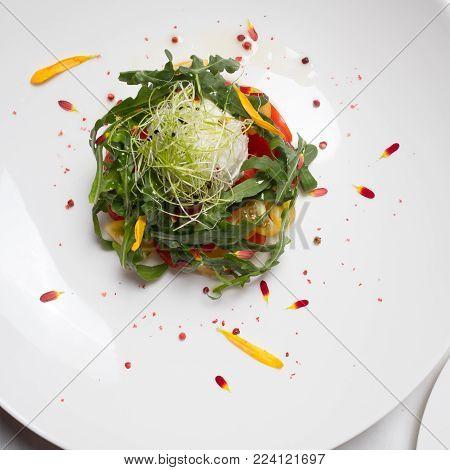 Healthy organic vegetable salad. Vegetarian food background. Fine dining concept