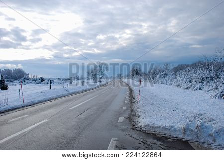 Country road through a snowy winter landscape