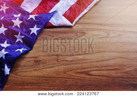 USA Flag on Brown Wooden Board. America Flag Background with Copy Space for MLK Day, President's Day, Patriot Day, 4th of July, Independence Day.