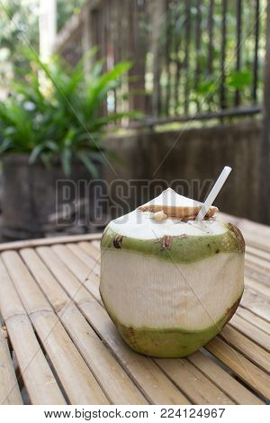 Thai's Coconut ready to drink on bamboo table