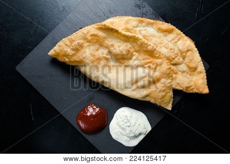 meat pasty or chebureki national Caucasian cuisine meal. Unhealthy fried fatty food.