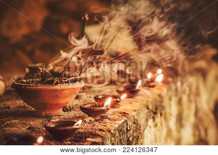 Smoke of the burning aromatic incense sticks inside temple. Incense for praying Buddha or Hindu gods to show respect.