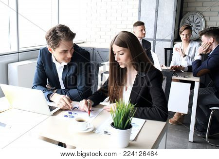 Young group of people doing their jobs on laptop