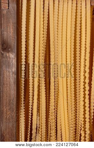 Preparation of Italian Ribbon-shaped Pasta: Reginette or Mafaldine.