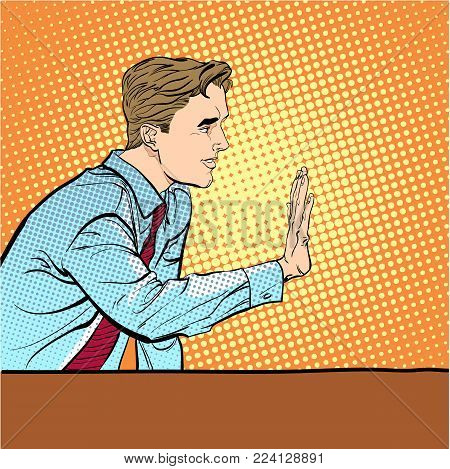 Sitting man stopping someone. Man stopping someone. Man rejecting something. Forbidding man. Handsome young businessman giving stop signal. Concept idea of advertisement and promo.