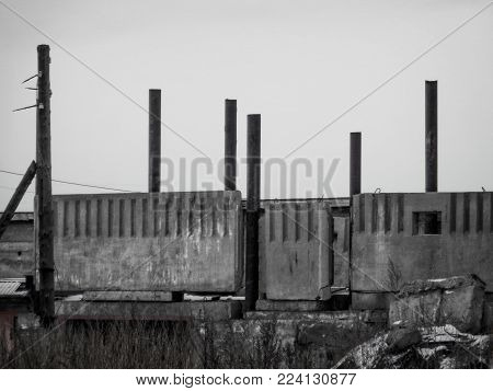 Pillars and concrete slabs. Unfinished object. Architectue
