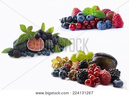 Set of fresh fruits and berries. Ripe blueberries, blackberries, red currants, grapes, raspberries, figs and plums. Various fresh summer berries on white background. Berries and fruits with copy space for text. Background berries.