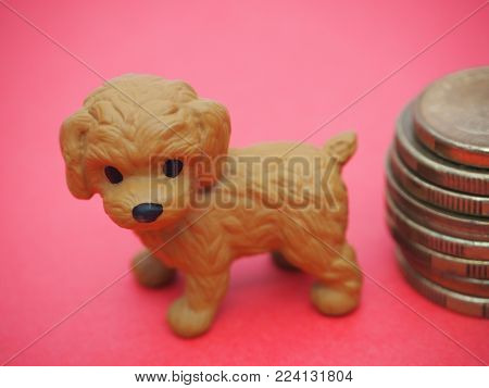 Happy Chinese New Year! 2018 Year of the Dog! Blessings for Chinese New Year 2018 (also known as Lunar New Year) on February 16. Cute little Dog on Red background next to a symbolic stack of 8 lucky gold coins.