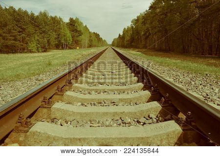 A railroad disappearing in a distant perspective