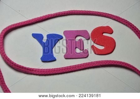word yes on ab stract colored background