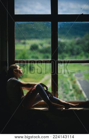 Young Girl Sleep On Window Sill With Summer Landscape View. Vacation, Wanderlust, Travel. Daydreamin