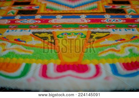 POKHARA, NEPAL - OCTOBER 06 2017: Close up of a detailed and colorful typical handmade carved structure in the ground of the building, inside of The Pema Ts al Sakya Monastic Institute, in Kathmandu Nepal.