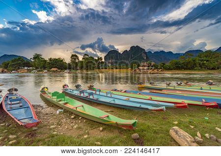 Long Tail Boats On Sunset At Song River, Vang Vieng, Laos.