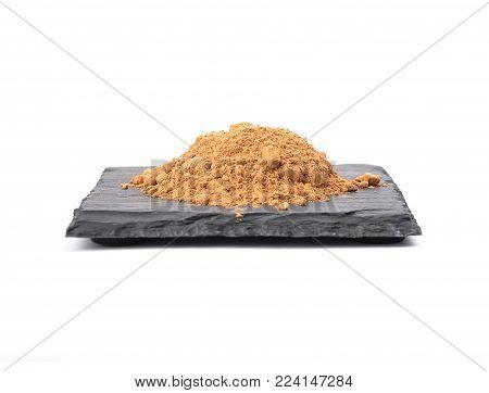 Colorful and crisp image of carob powder on shale and white