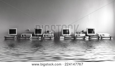 Black and white photo cabinet with computers flooded with water