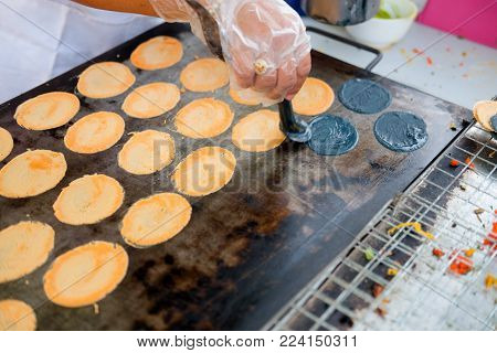 Cooking Ancient Indigenous Khanom Beaung Thai Or A Kind Of Filled Pancake Thai Food Or Thai Style Cr