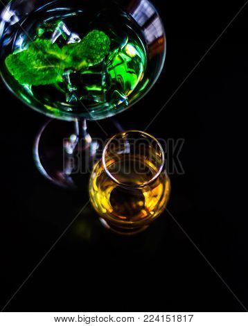 Single Malt Whiskey In A Glass And Green Mint Liqueur, Refreshing Set Of Drinks